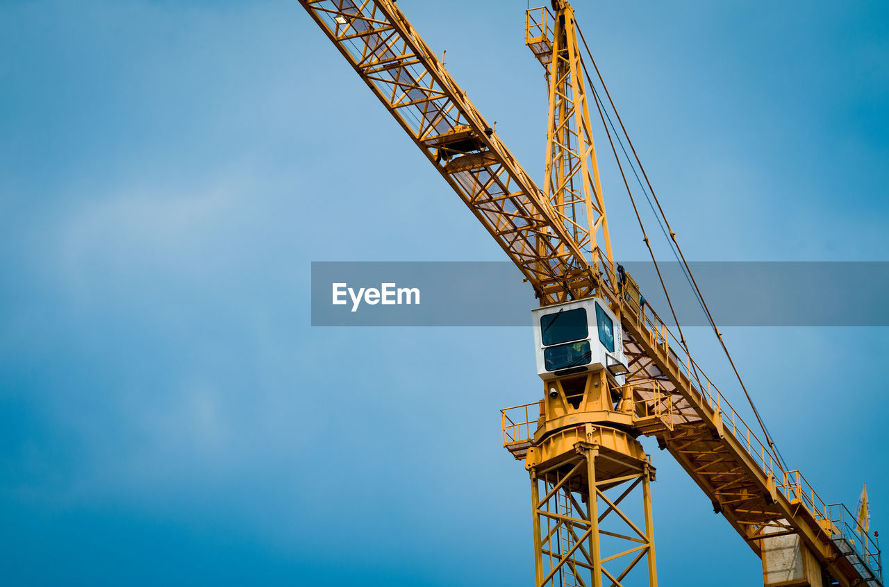 industry, sky, machinery, crane - construction machinery, low angle view, nature, blue, metal, no people, outdoors, construction industry, development, architecture, built structure, cloud - sky, day, technology, construction site, construction machinery, equipment, construction equipment, industrial equipment