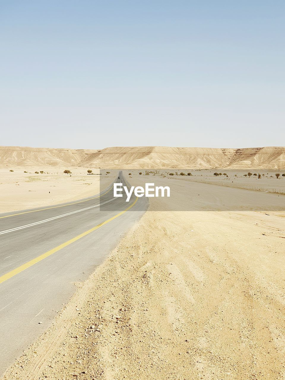 Scenic view of road against clear sky