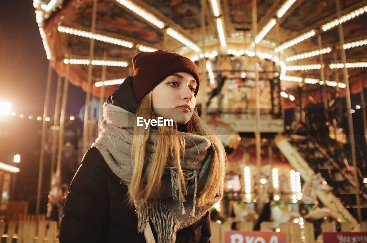 Woman Looking At Amusement Park During Winter