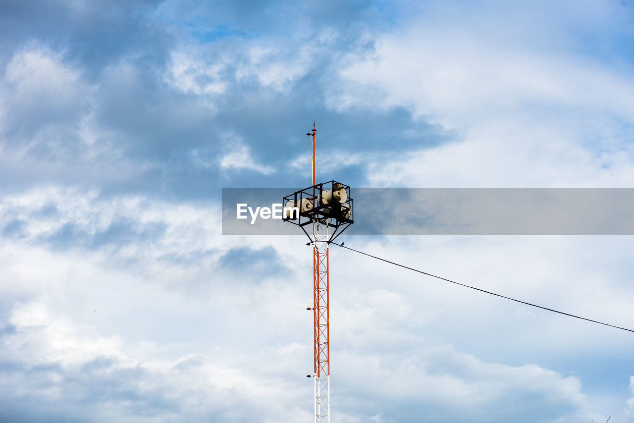 cloud - sky, low angle view, sky, technology, communication, day, nature, lighting equipment, electricity, no people, connection, outdoors, pole, street, tower, tall - high, metal, built structure, street light, floodlight, light, power supply, electrical equipment, global communications