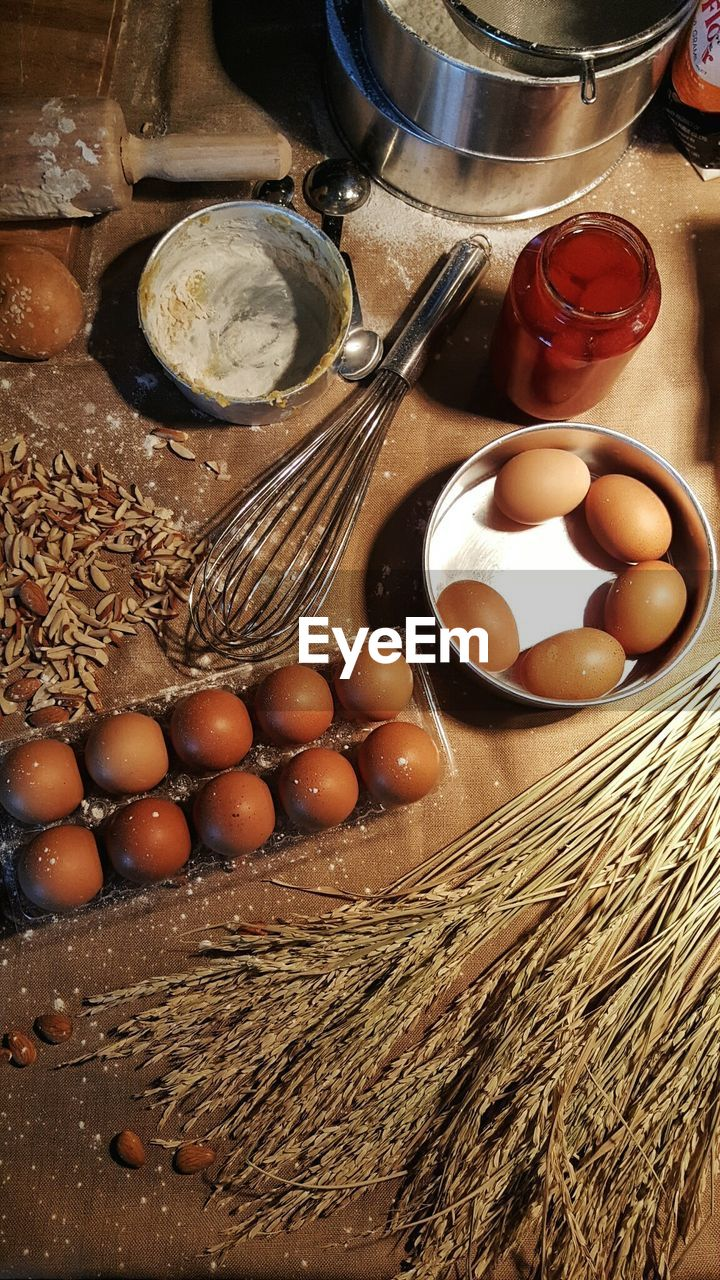 Directly Above Shot Of Wheat Plants And Eggs On Table