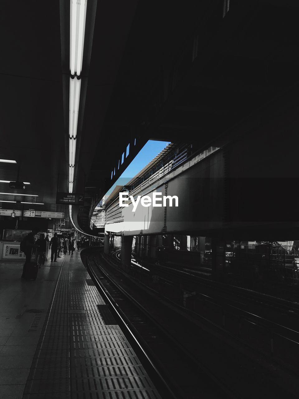 TRAIN AT RAILROAD STATION PLATFORM AGAINST CLEAR SKY