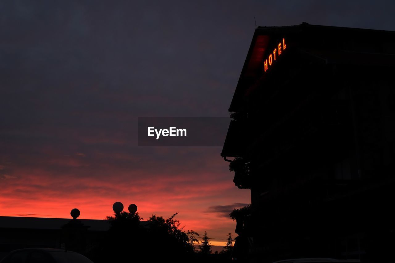 Low Angle View Of Hotel Building Against Sky During Sunset