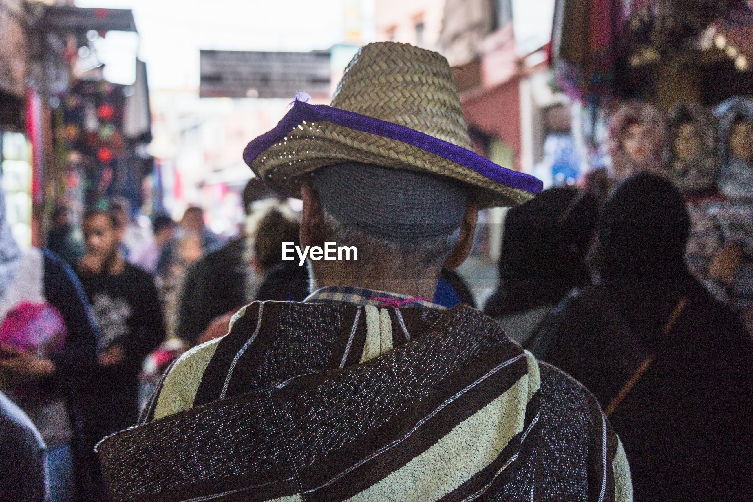 Rear view of man in hat on street