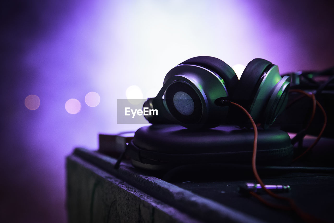 Close-Up Of Headphones On Table At Nightclub