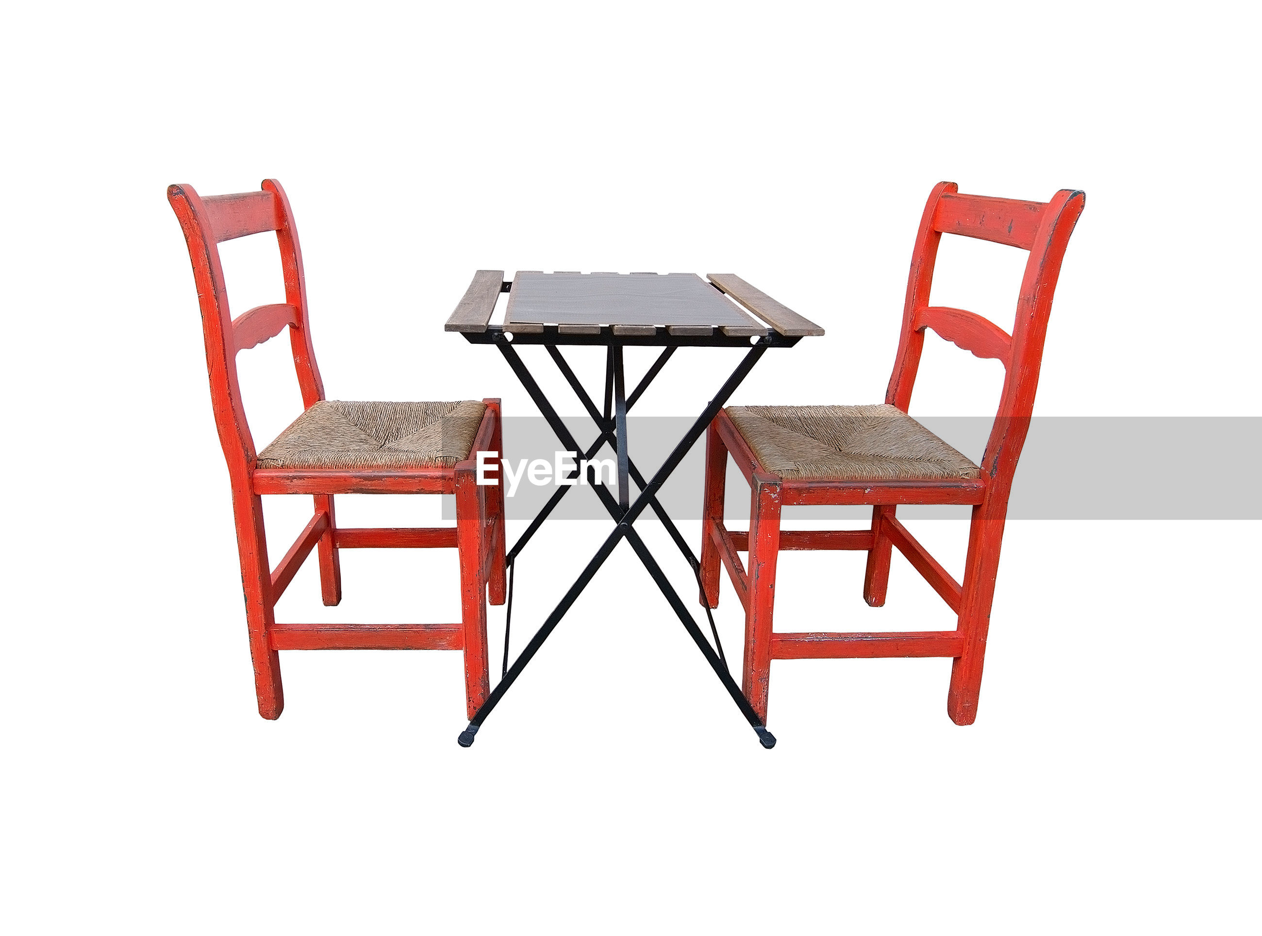 Chairs and table against white background