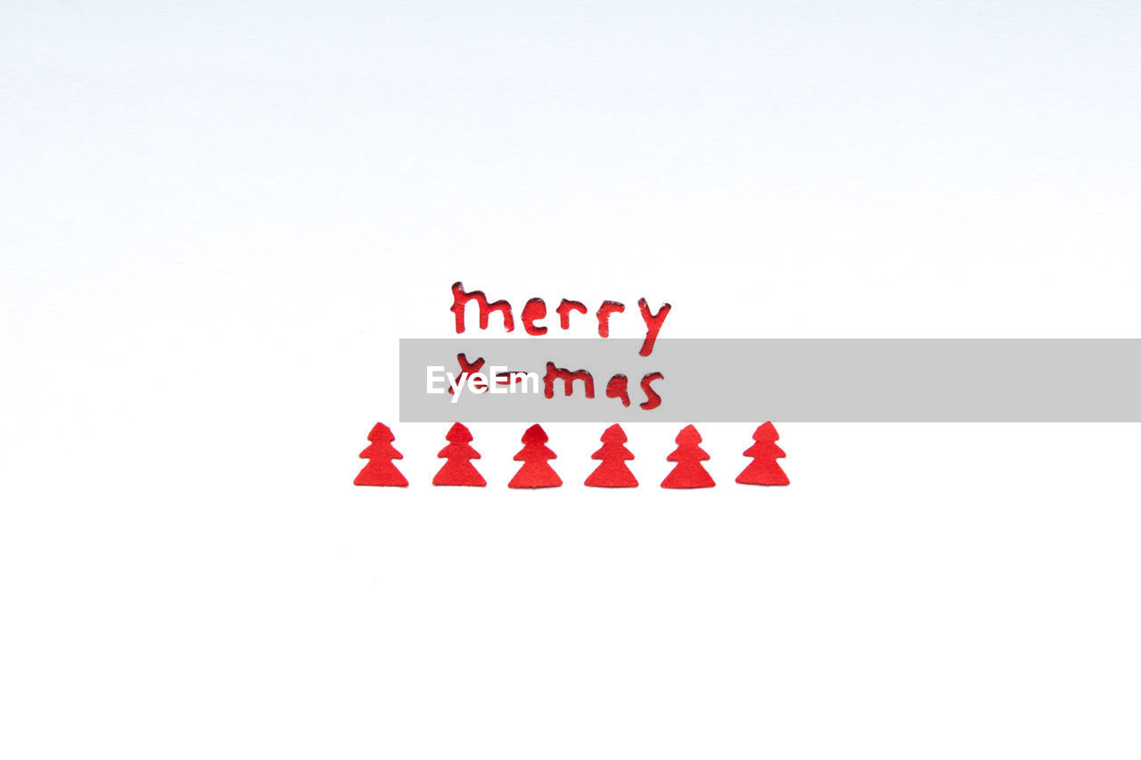 Close-up of christmas text on white paper