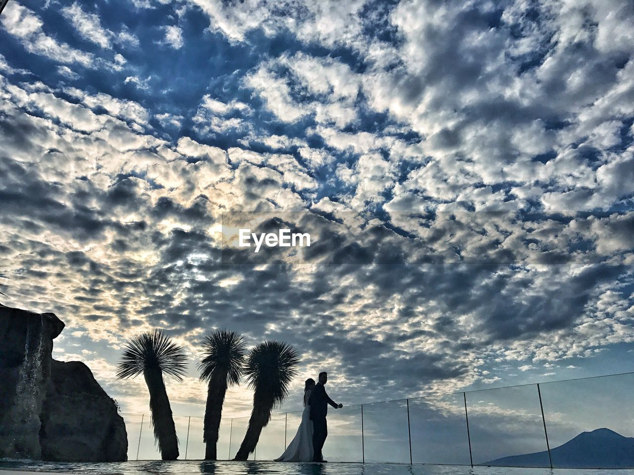 cloud - sky, sky, outdoors, real people, nature, day, lifestyles, low angle view, standing, beauty in nature, men, togetherness, people
