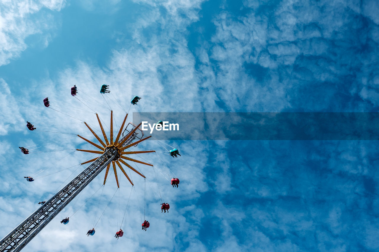 Low Angle View Of Amusement Park Ride Against Sky