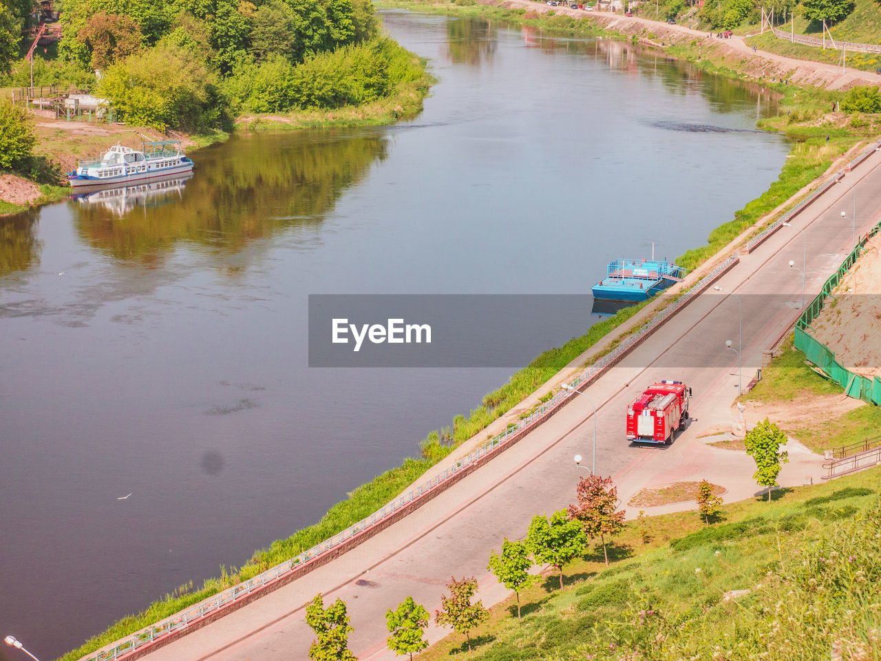 water, high angle view, transportation, day, plant, nature, mode of transportation, tree, no people, architecture, outdoors, built structure, river, nautical vessel, road, reflection, city, building exterior, beauty in nature