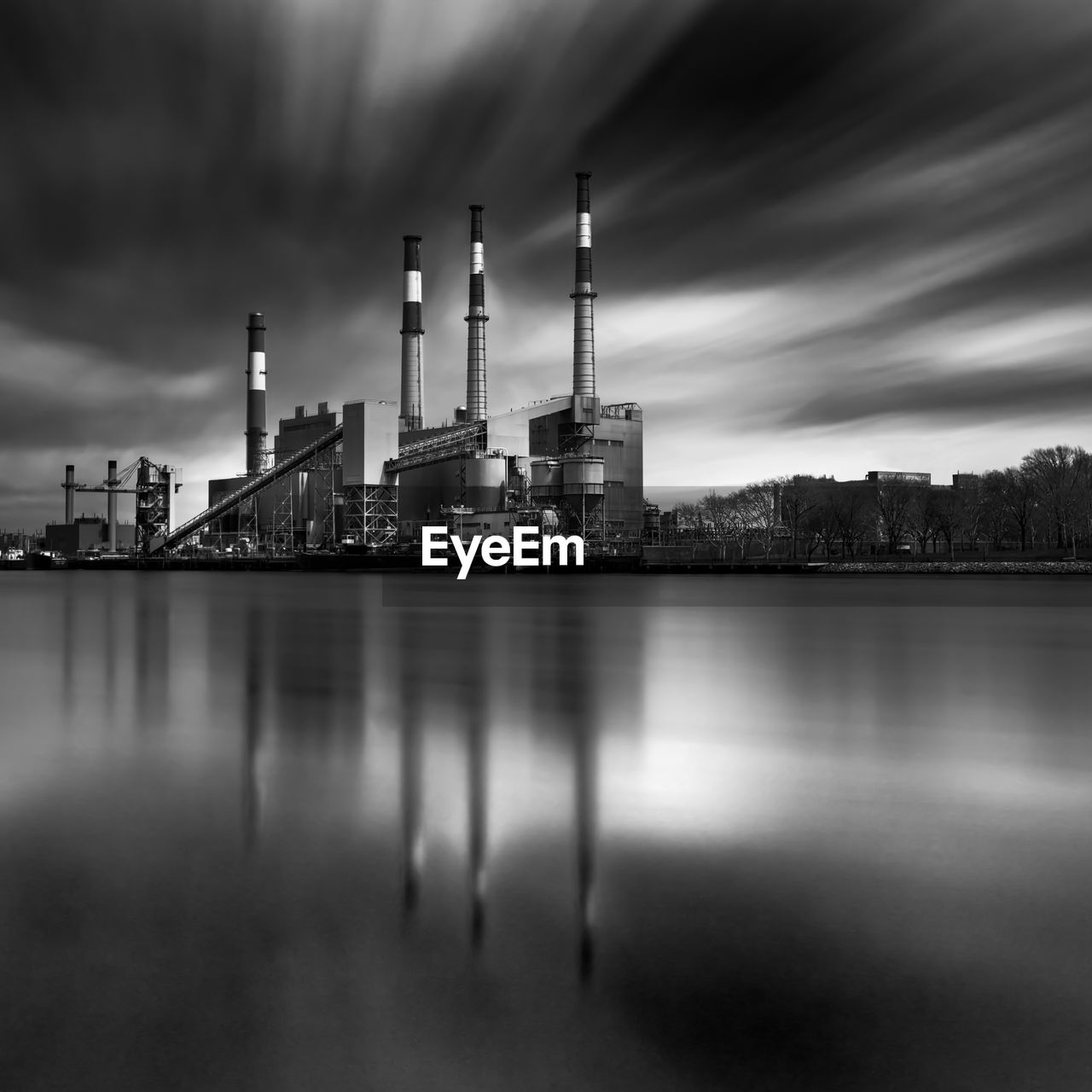 Long Exposure Of Reflection Of Factory In Sea