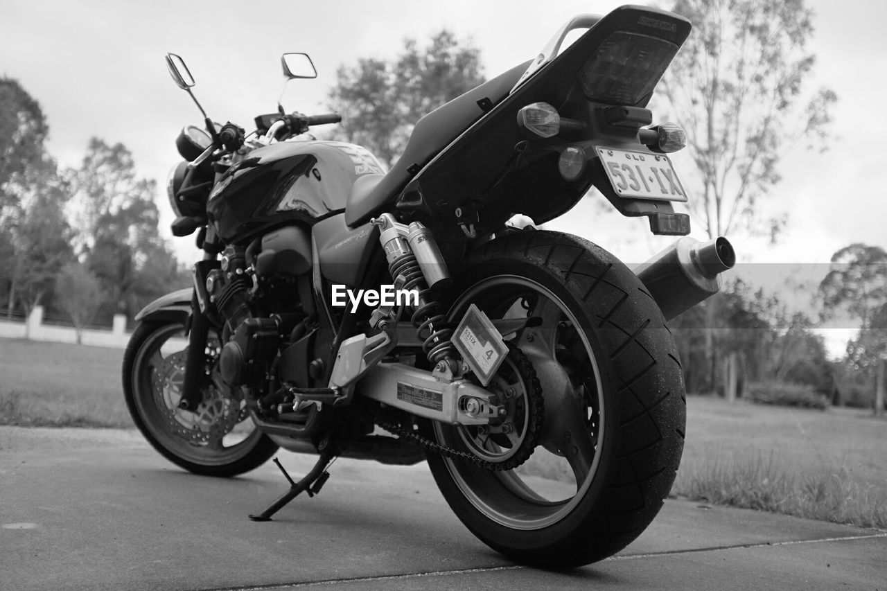 motorcycle, transportation, outdoors, day, mode of transport, land vehicle, men, one person, real people, tree, close-up, people
