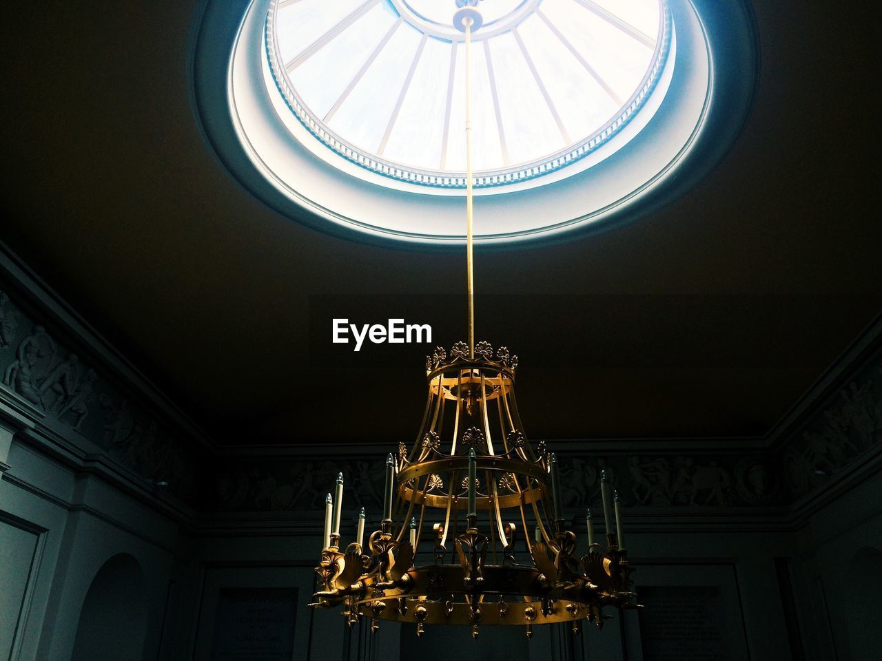Close-Up Of Chandelier Hanging From Cupola