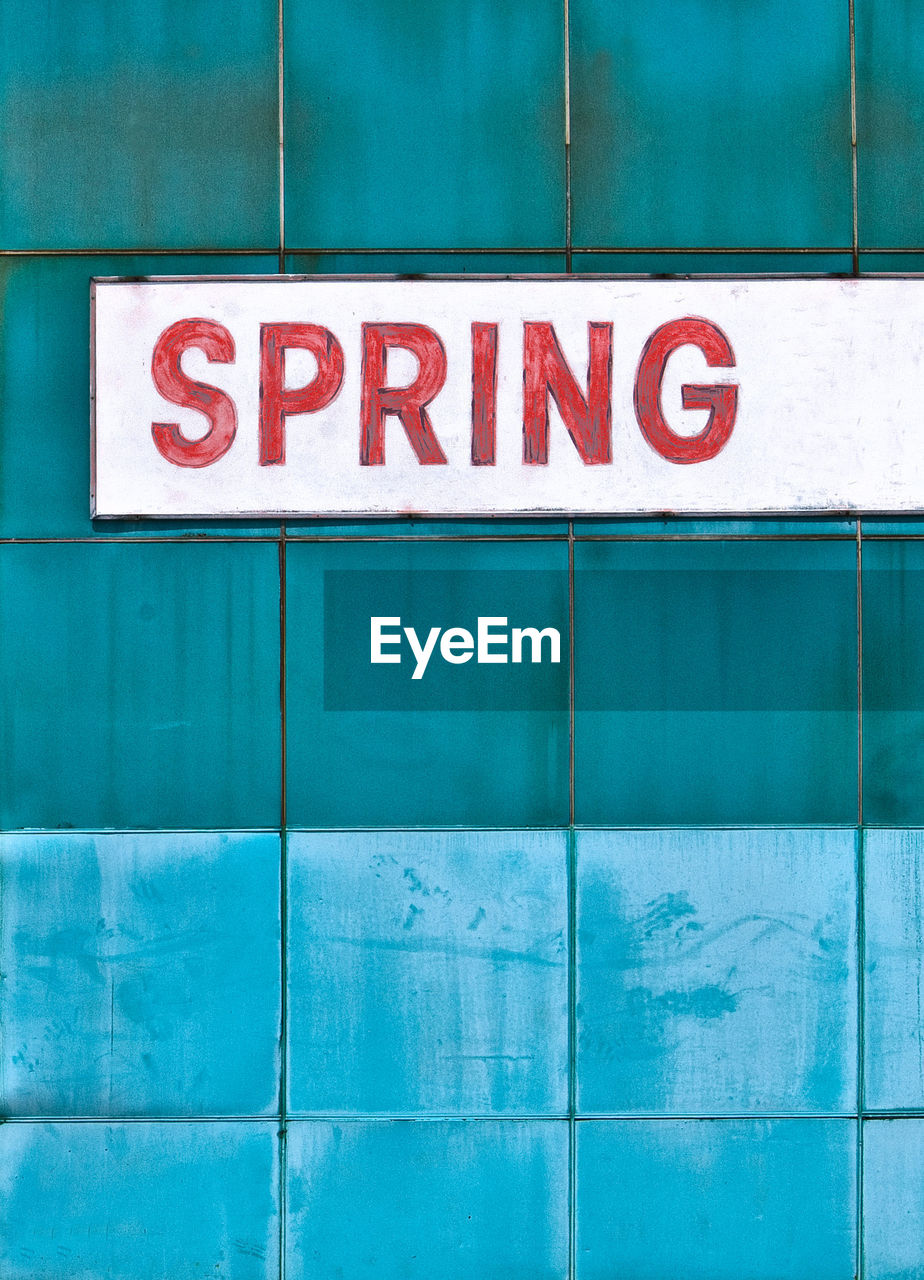 Spring Text On Blue Wall