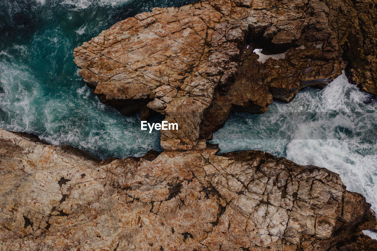 High angle view of rock formation by sea