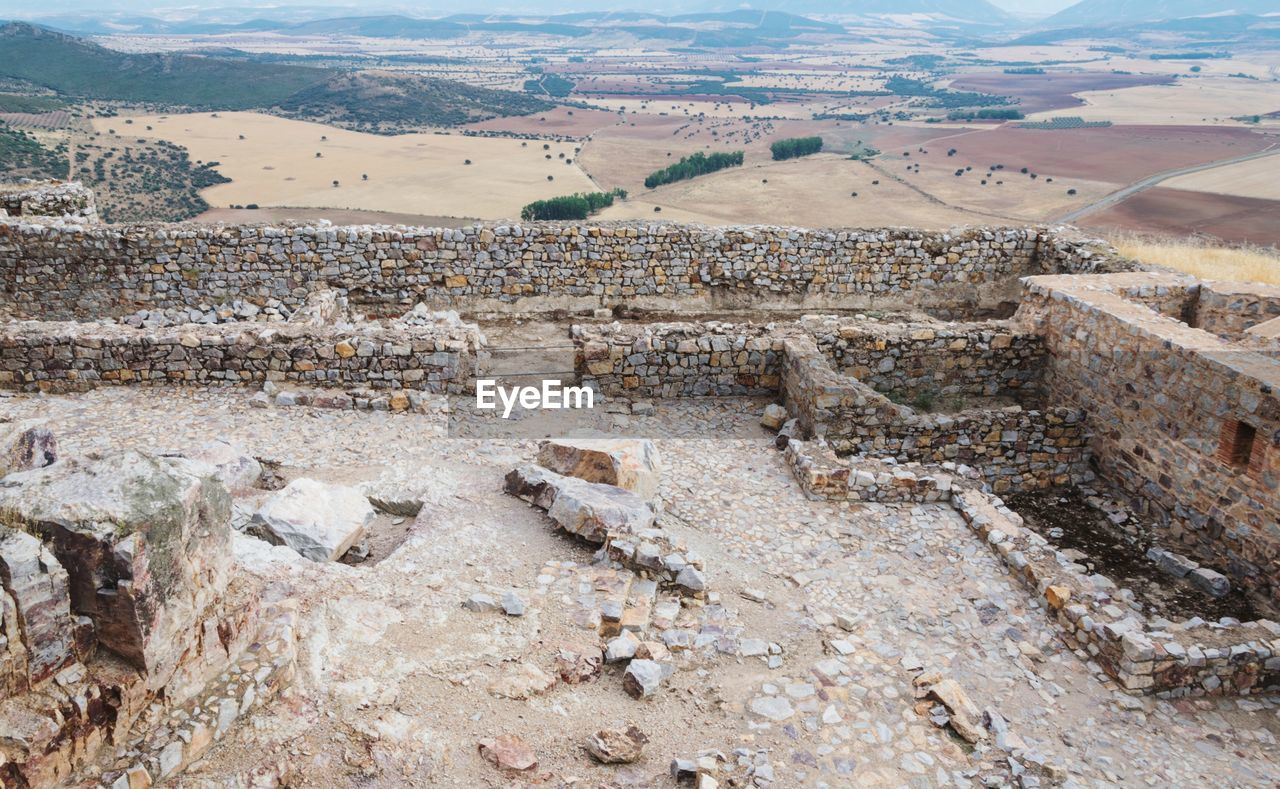 landscape, environment, history, high angle view, day, architecture, the past, no people, nature, travel destinations, ancient, tranquil scene, scenics - nature, mountain, outdoors, travel, tranquility, ancient civilization, built structure, land, climate, arid climate, archaeology, quarry, ancient history