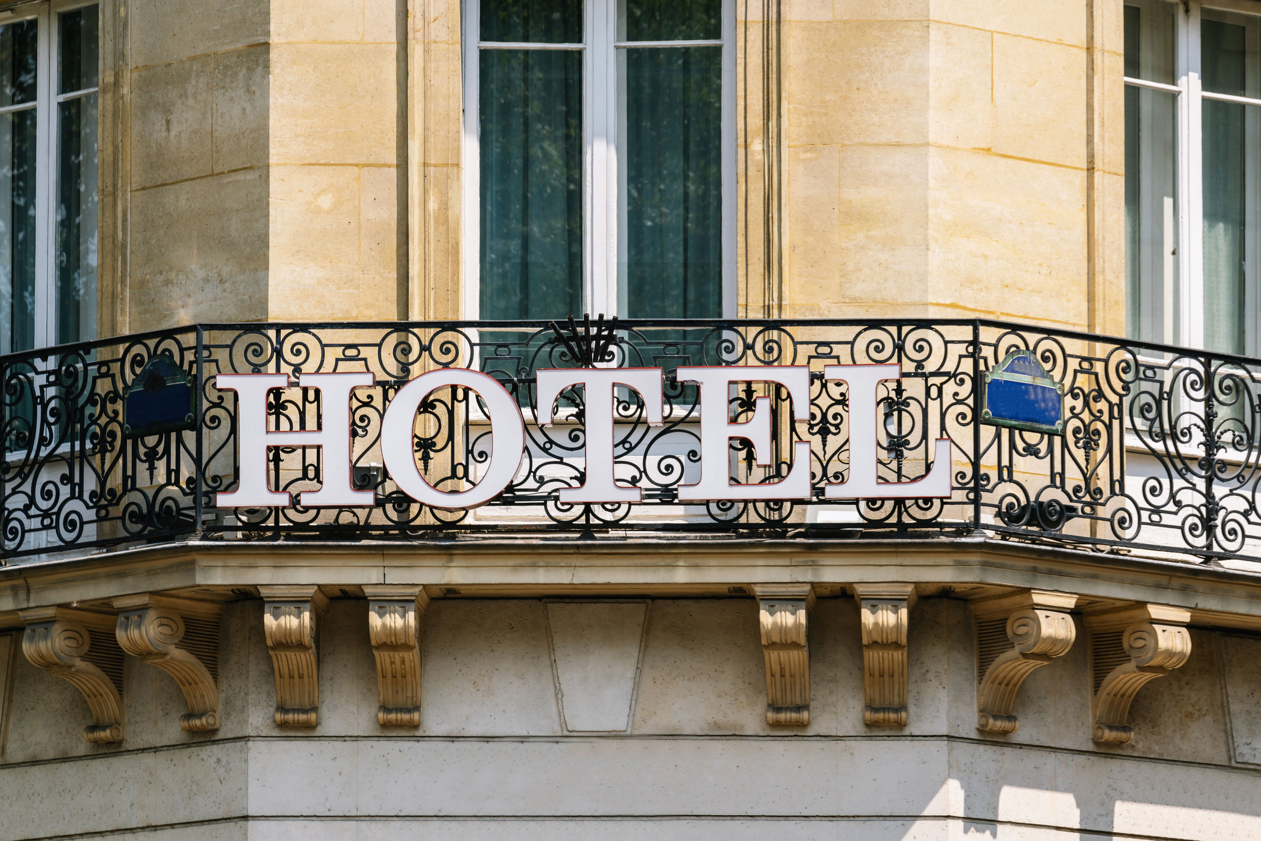 Low angle view of building with hotel sign