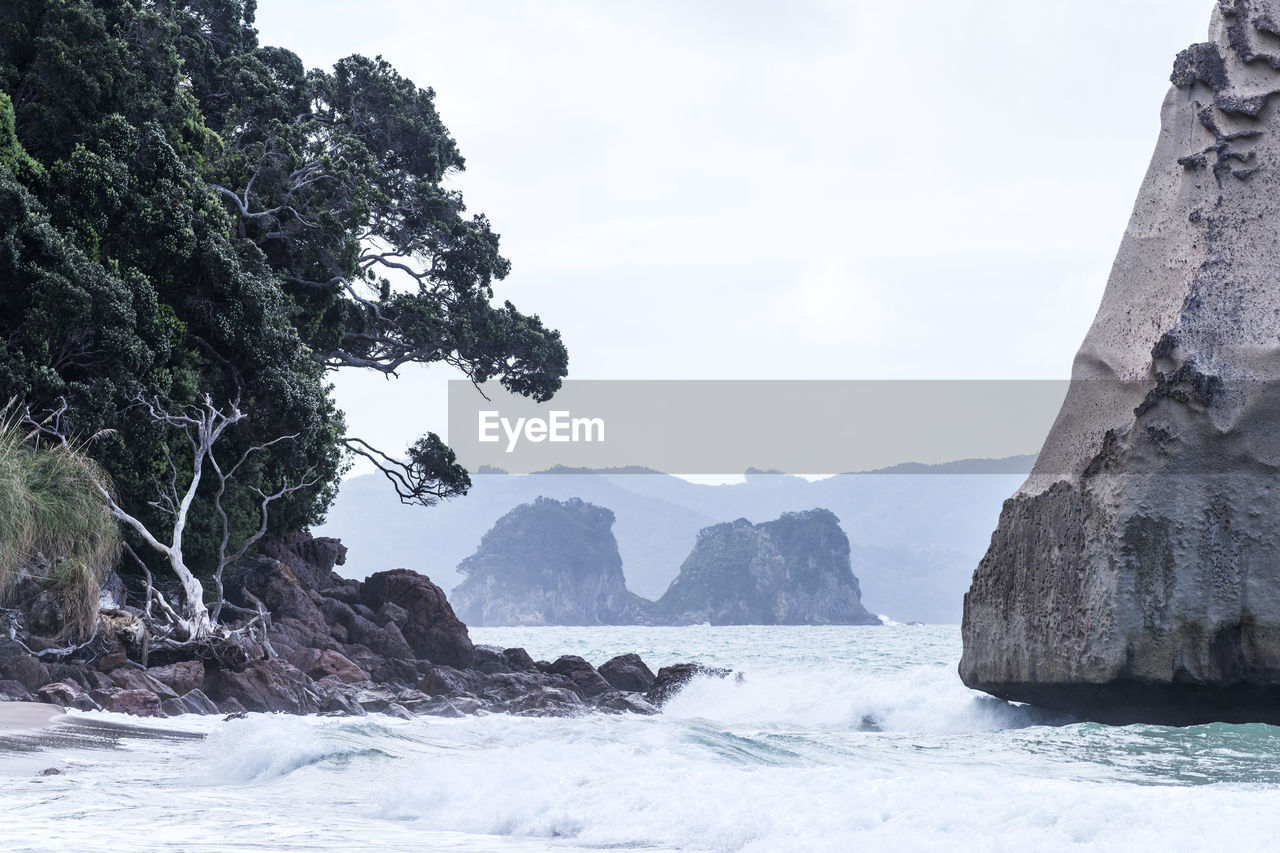 sea, rock - object, nature, rock formation, water, beauty in nature, outdoors, tranquility, day, cliff, scenics, mountain, sky, no people, tree
