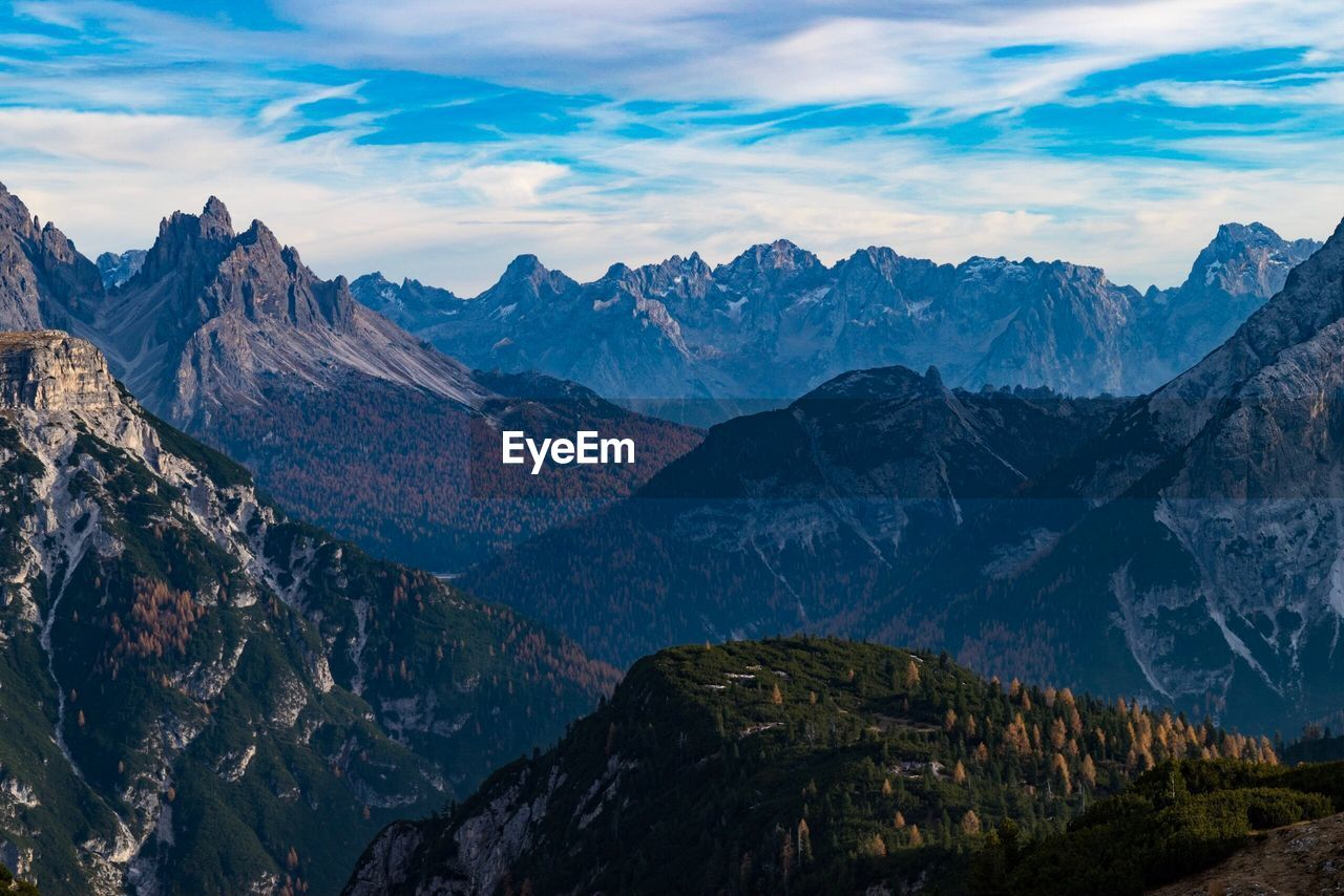 mountain, sky, mountain range, scenics - nature, beauty in nature, cloud - sky, tranquil scene, environment, landscape, tranquility, nature, non-urban scene, mountain peak, idyllic, no people, cold temperature, rock, remote, outdoors, formation, snowcapped mountain, height, high