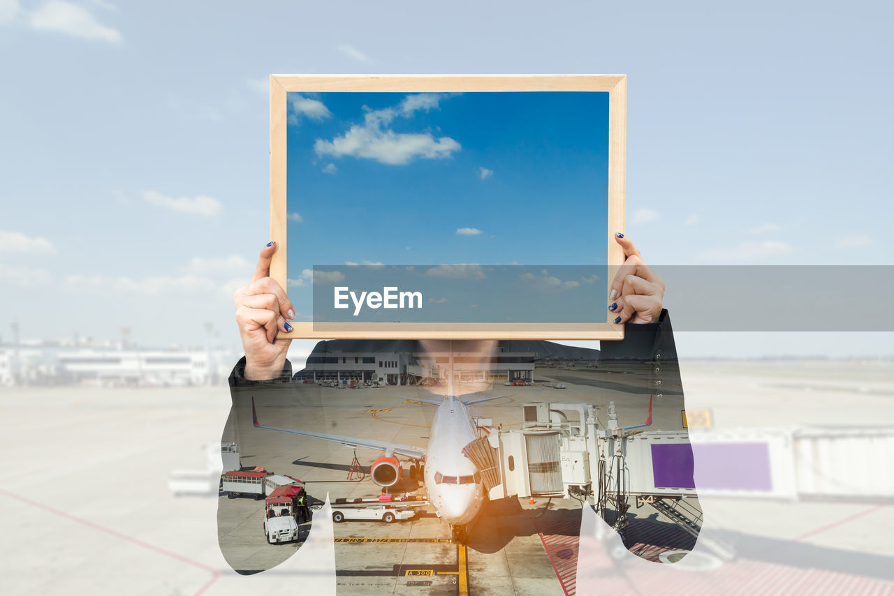 Digital Composite Image Of Woman Holding Frame At Airport