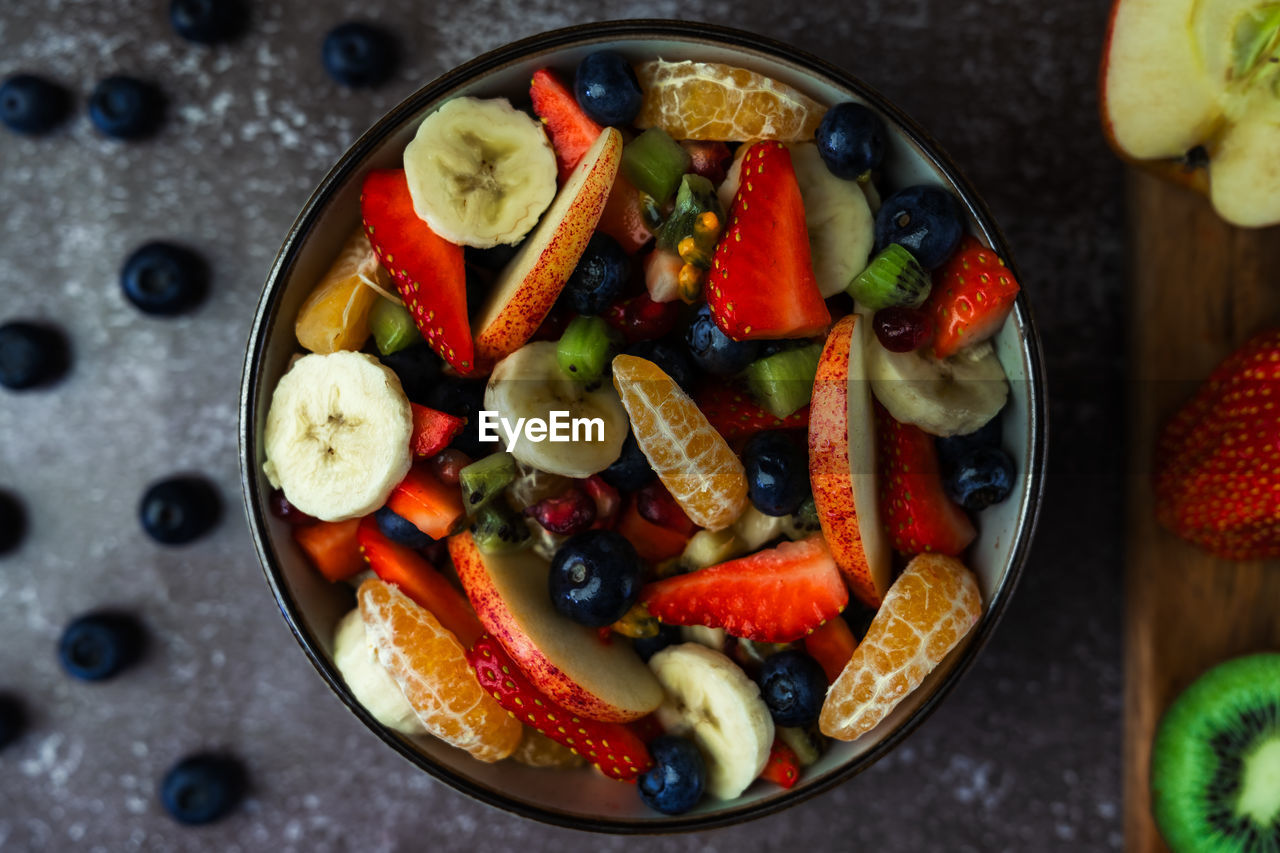 Overhead view of fruit salad in bowl on table