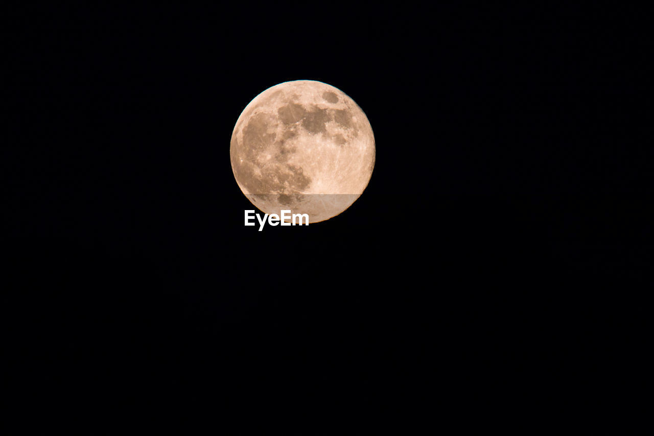 astronomy, space, moon, sky, night, planetary moon, beauty in nature, scenics - nature, circle, tranquility, full moon, geometric shape, copy space, shape, low angle view, no people, idyllic, nature, clear sky, tranquil scene, outdoors, space and astronomy, moonlight, eclipse