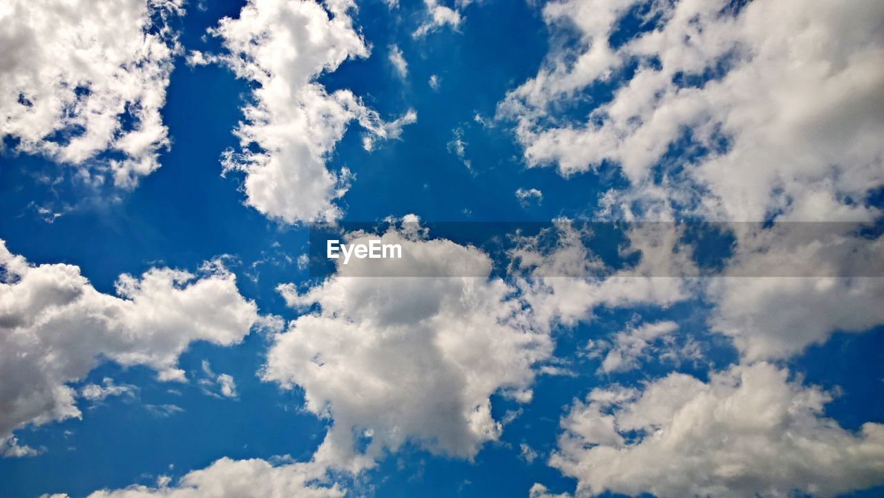beauty in nature, blue, nature, cloud - sky, sky, backgrounds, scenics, full frame, atmospheric mood, white color, sky only, cloudscape, low angle view, tranquility, vibrant color, no people, day, softness, idyllic, outdoors, tranquil scene