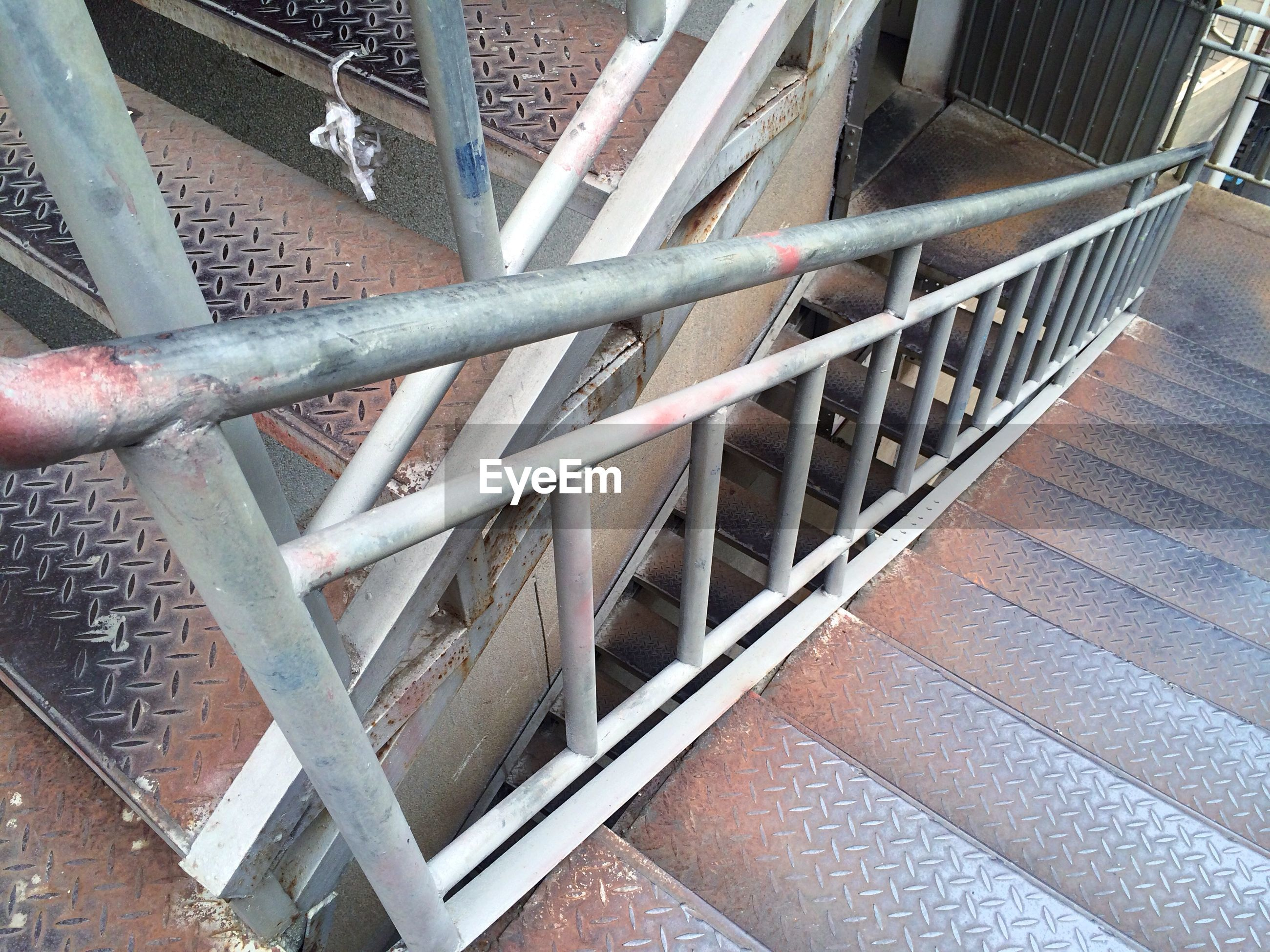 metal, indoors, built structure, architecture, pattern, metallic, railing, steps and staircases, staircase, steps, high angle view, low angle view, full frame, day, no people, repetition, backgrounds, ceiling, roof, building exterior