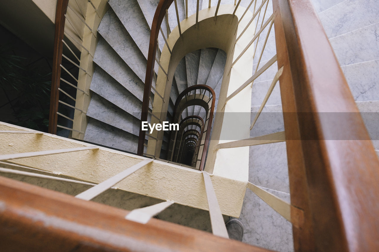 architecture, built structure, staircase, steps and staircases, spiral, spiral staircase, railing, building exterior, building, no people, day, high angle view, metal, pattern, design, selective focus, focus on background, wood - material