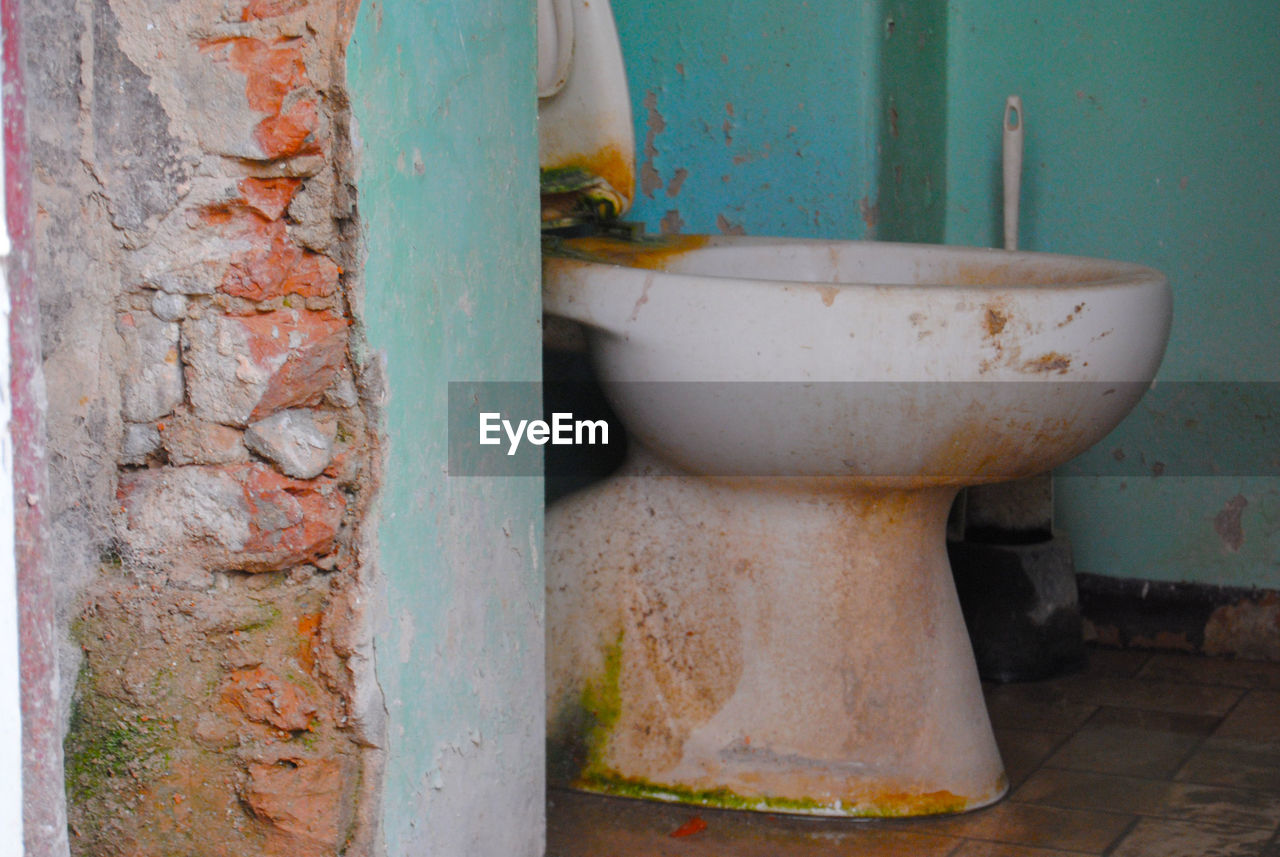 abandoned, bathroom, old, toilet, no people, decline, run-down, deterioration, damaged, obsolete, wall - building feature, weathered, rusty, bad condition, metal, toilet bowl, domestic bathroom, indoors, domestic room, day, dirty