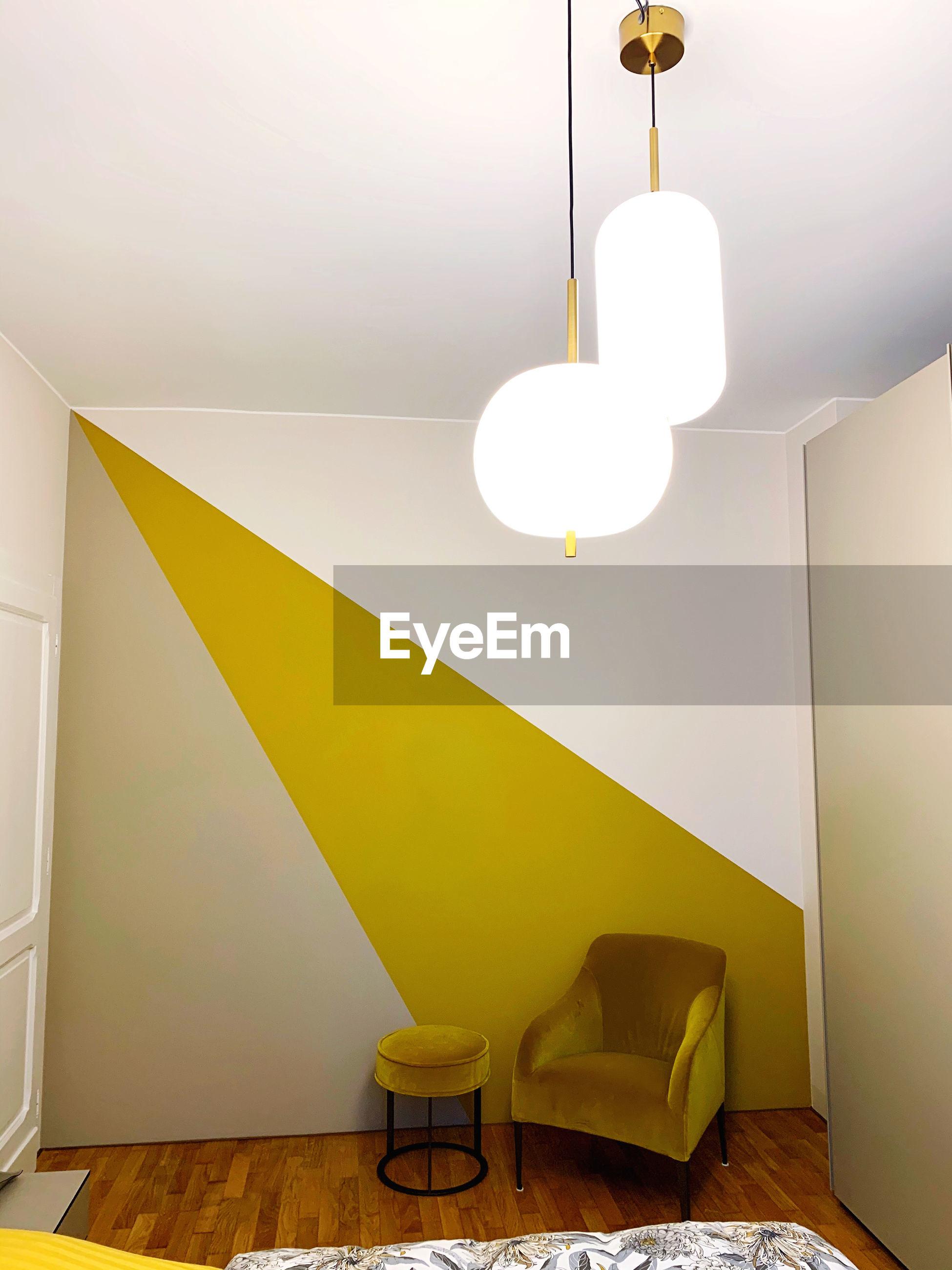 ILLUMINATED LAMP IN ROOM