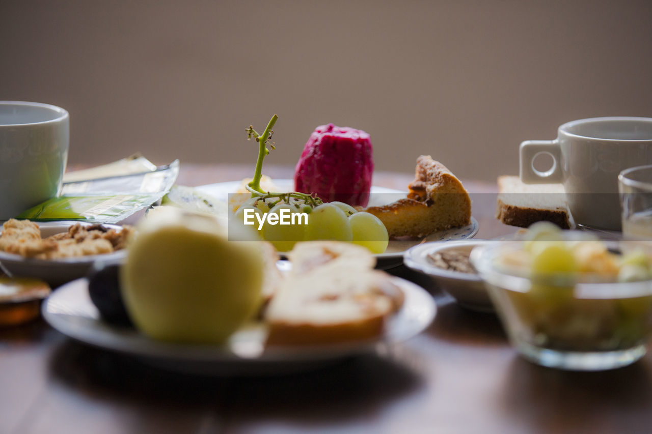 food and drink, food, healthy eating, table, fruit, freshness, wellbeing, plate, indoors, drink, selective focus, no people, ready-to-eat, still life, meal, serving size, breakfast, cup, refreshment, bowl, glass, fruit salad, temptation