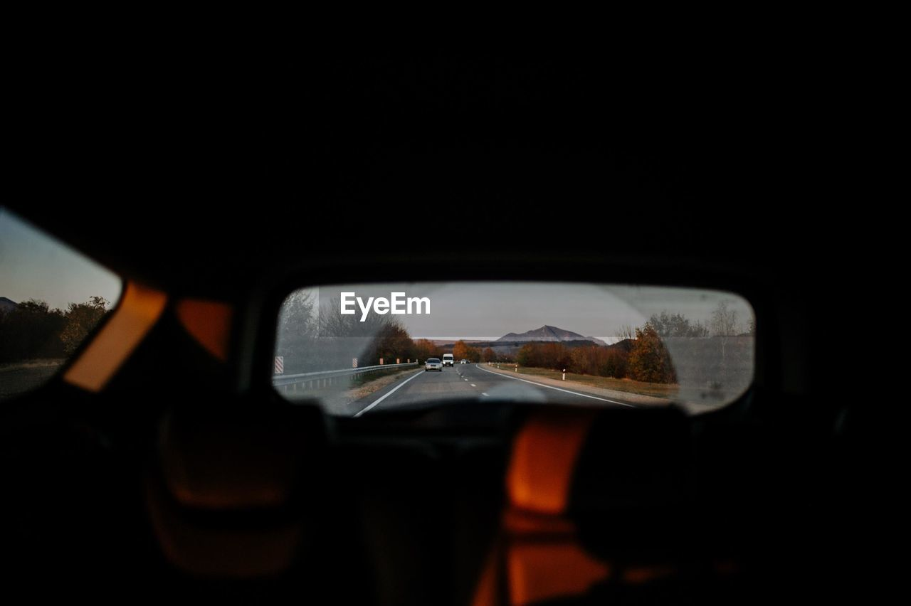 Reflection of road in rear view mirror
