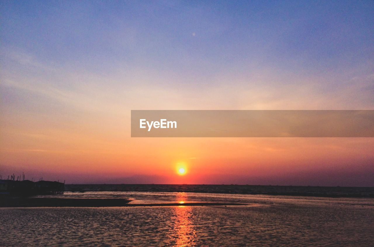 sky, sunset, water, beauty in nature, tranquility, sea, scenics - nature, tranquil scene, cloud - sky, orange color, nature, sun, waterfront, no people, idyllic, outdoors, horizon, beach, land