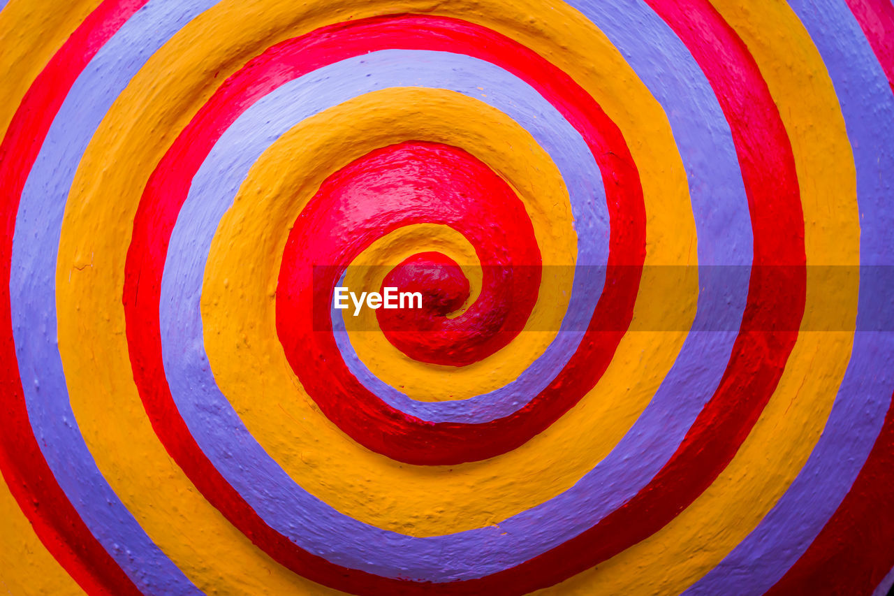 multi colored, full frame, backgrounds, pattern, circle, close-up, no people, geometric shape, yellow, orange color, shape, indoors, day, art and craft, still life, spiral, design, abstract, vibrant color, red, concentric