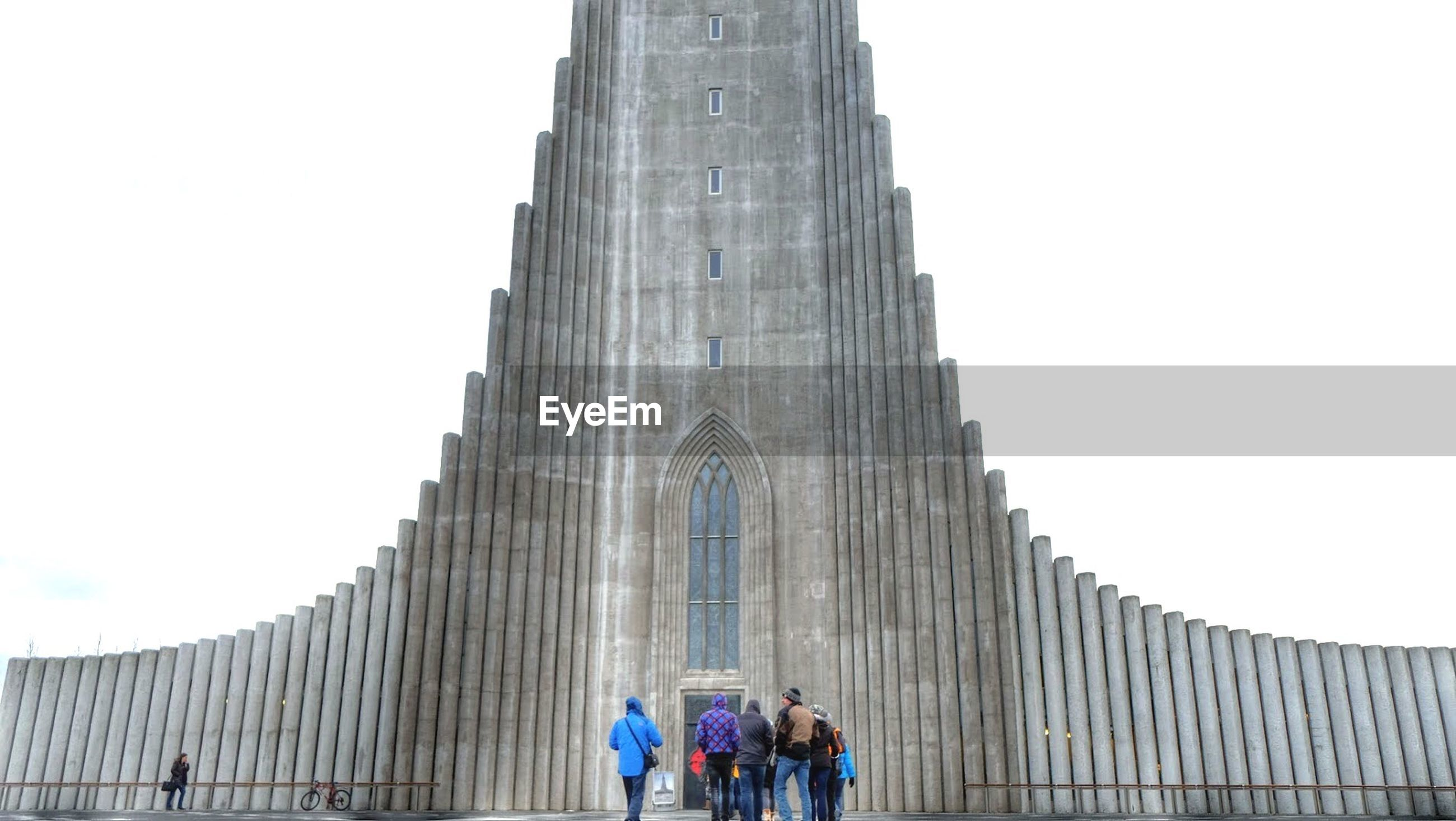 Rear view of people at hallgrímskirkja against clear sky