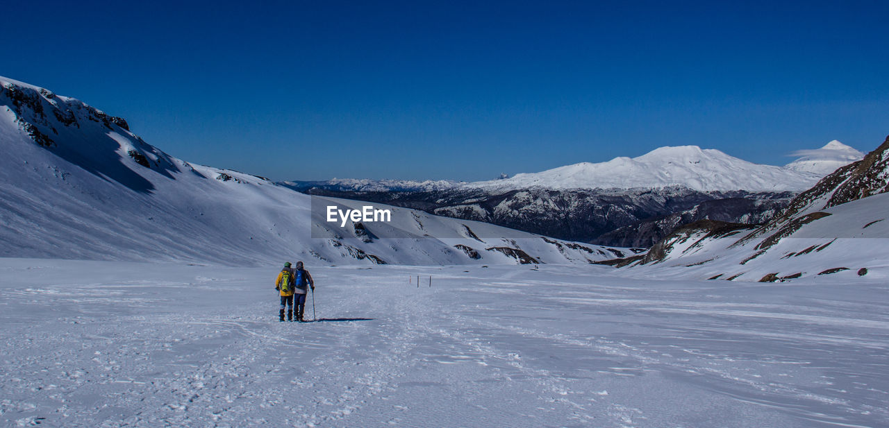 People Skiing On Snow Covered Mountain