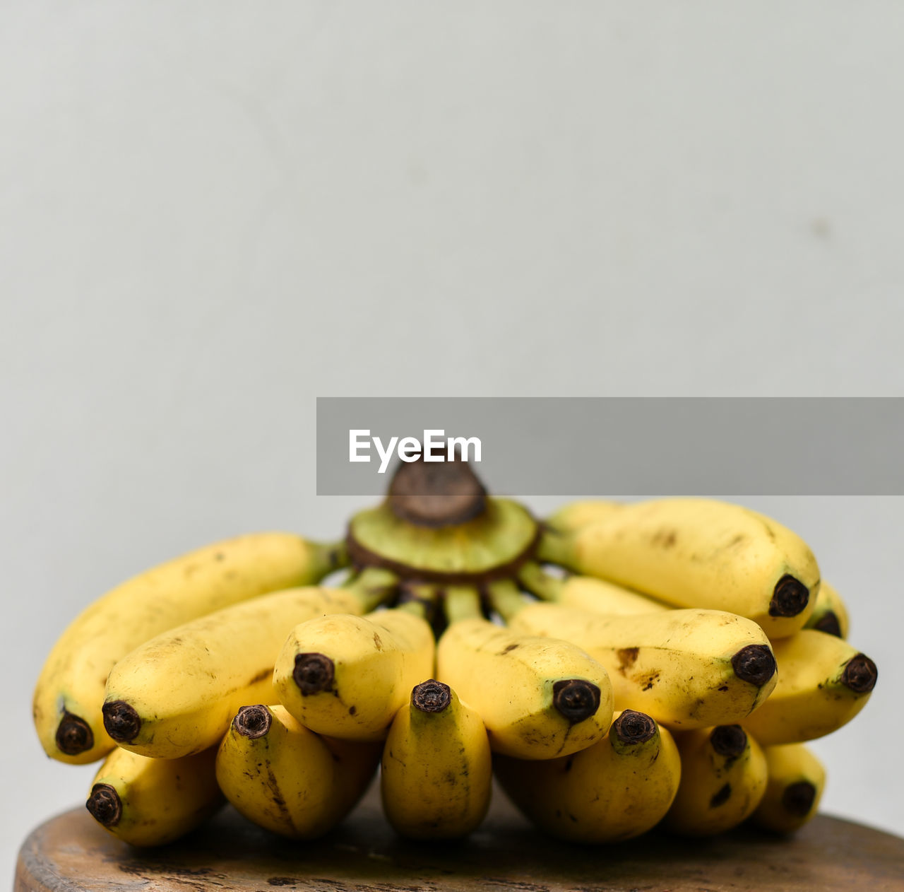 food and drink, healthy eating, food, still life, yellow, close-up, fruit, freshness, wellbeing, indoors, studio shot, copy space, no people, group of objects, banana, white background, focus on foreground, table, ripe, group, temptation