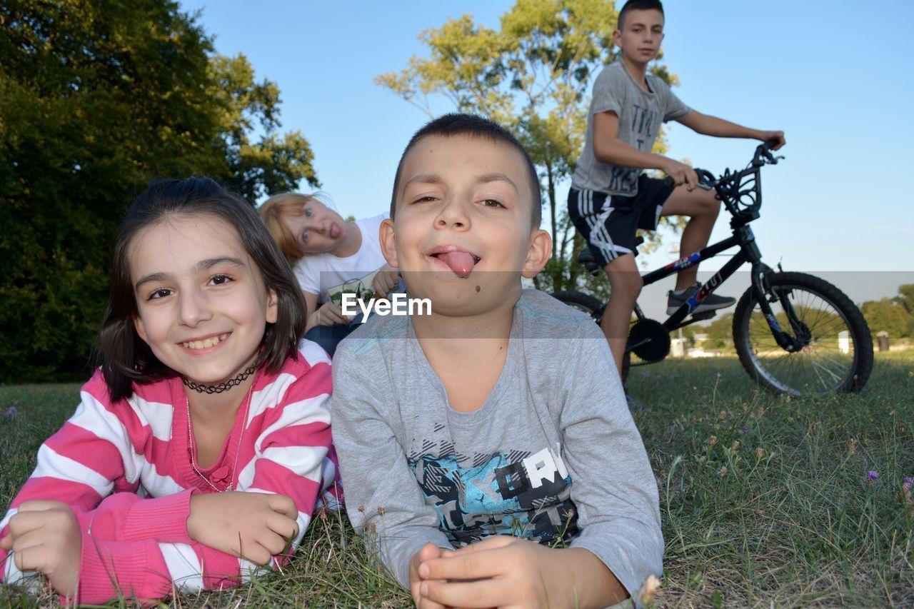 Portrait of siblings at park
