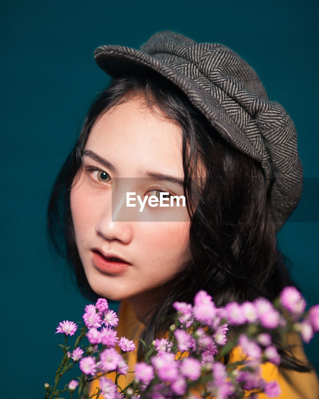 Close-up portrait of beautiful woman with flowers