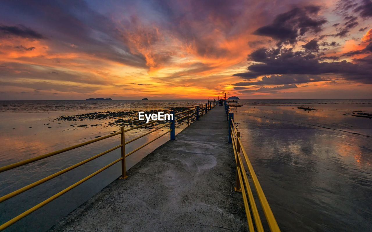 sunset, sky, water, cloud - sky, beauty in nature, scenics - nature, sea, orange color, nature, idyllic, tranquil scene, land, tranquility, beach, horizon, non-urban scene, horizon over water, wood - material, the way forward, no people, diminishing perspective, outdoors