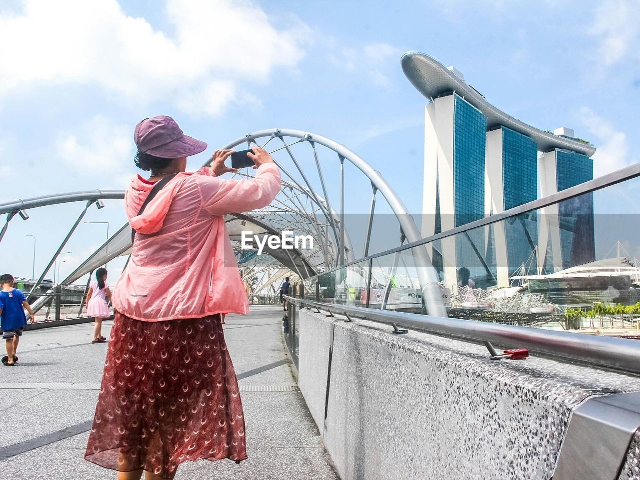 one person, bridge - man made structure, real people, leisure activity, lifestyles, sky, built structure, day, casual clothing, outdoors, standing, architecture, city, young adult, adult, people, adults only