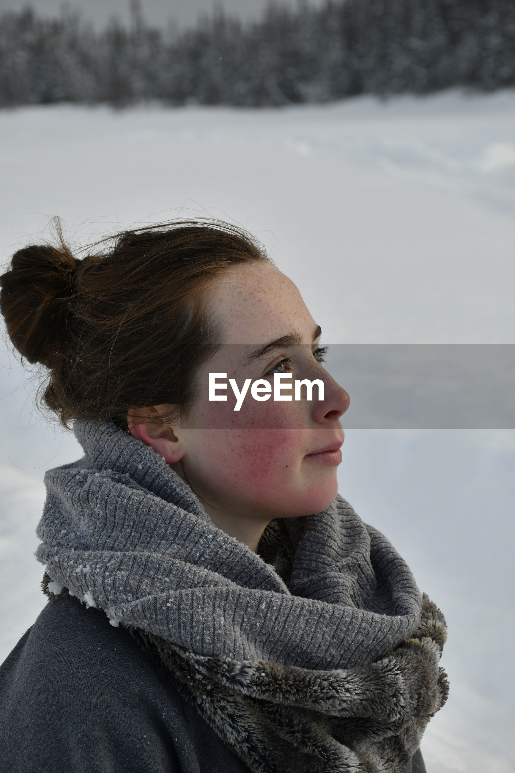 Woman looking away during winter