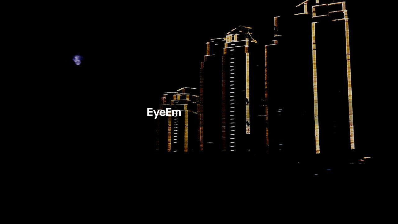 night, no people, architecture, black background, built structure, illuminated, outdoors, close-up, sky