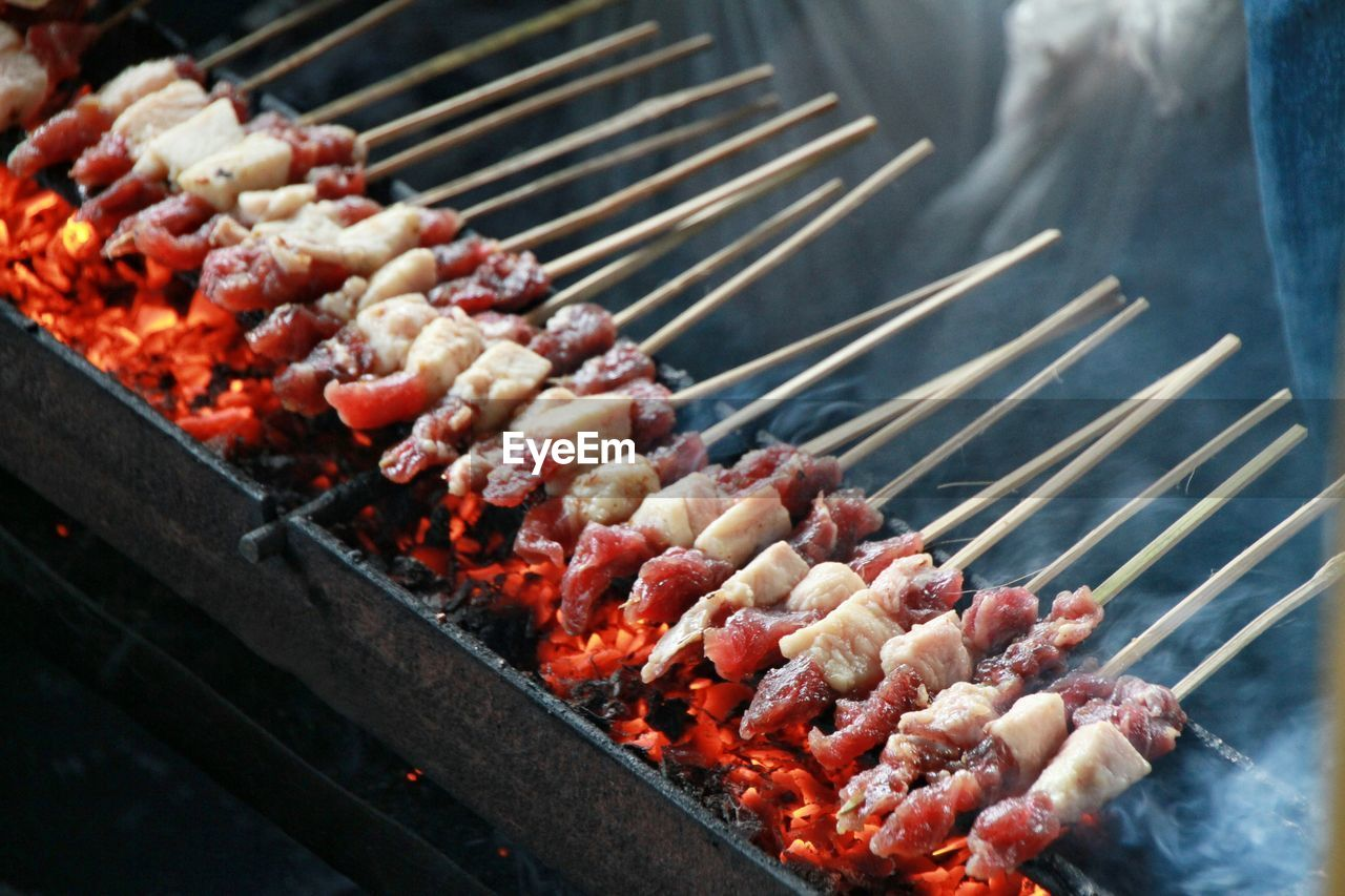 High Angle View Of Food Cooking On Barbeque