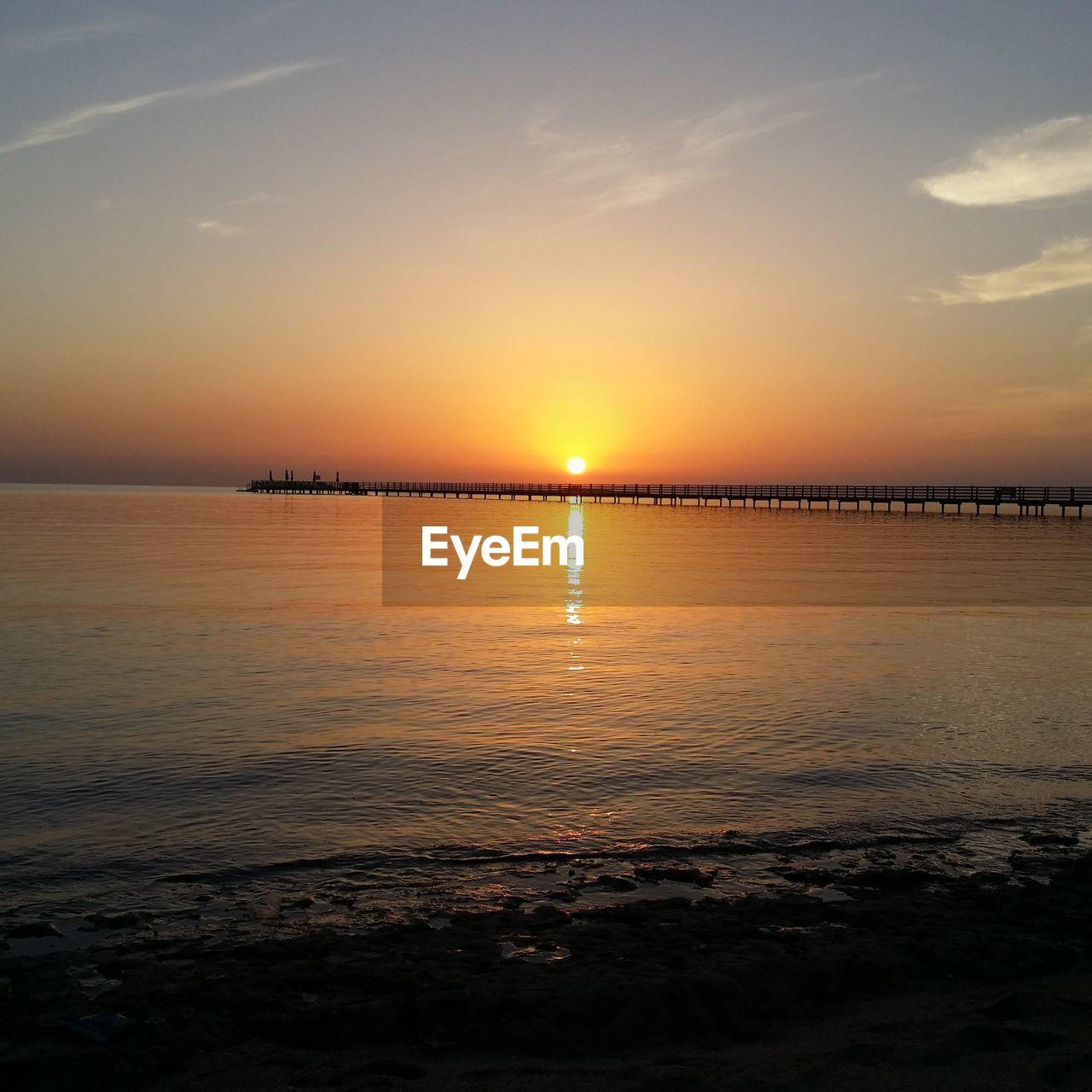 sunset, sky, scenics - nature, beauty in nature, water, tranquil scene, tranquility, sun, sea, orange color, horizon, horizon over water, reflection, nature, idyllic, no people, non-urban scene, sunlight, beach, outdoors, salt flat