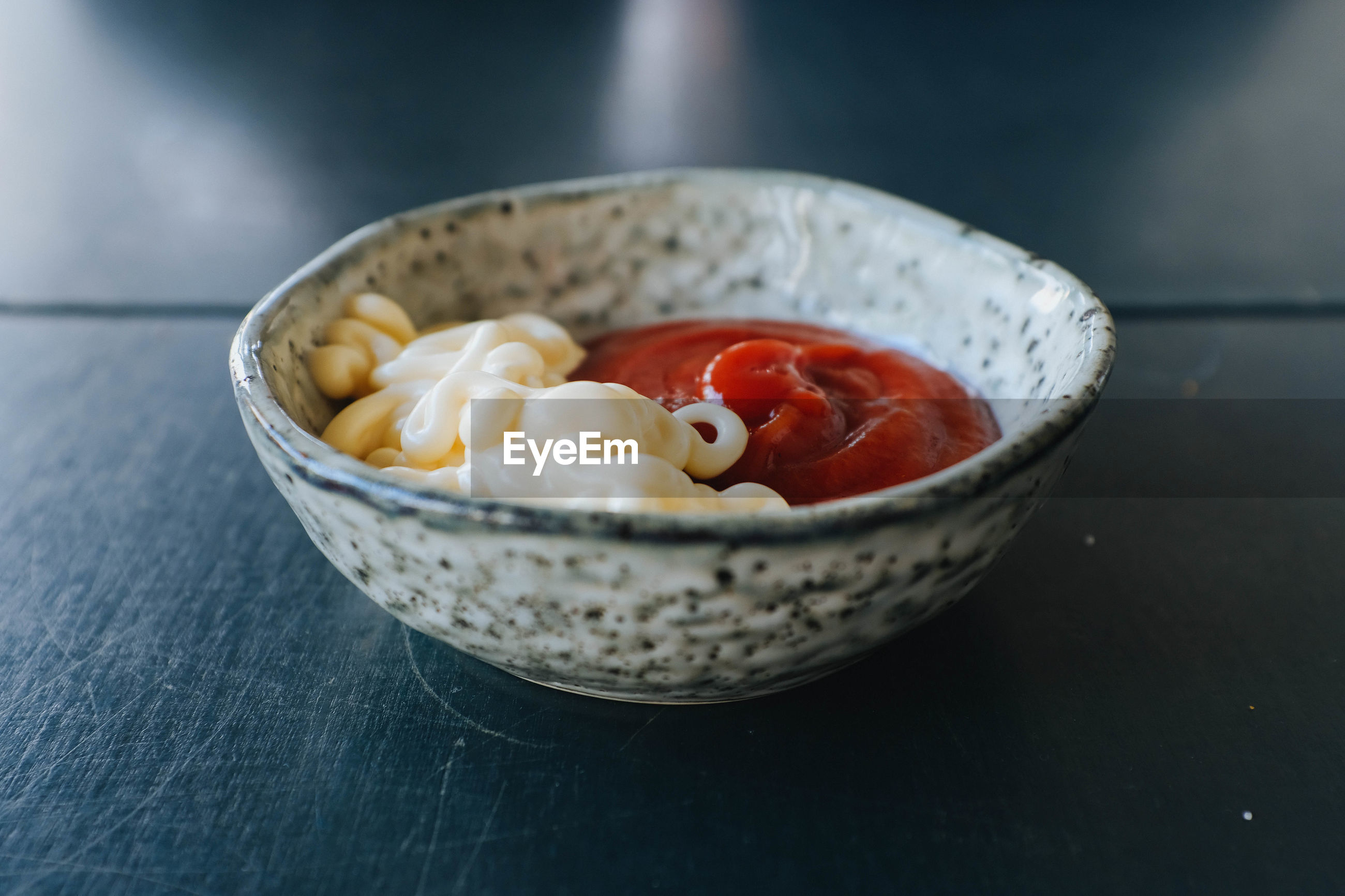 Close-up of condiments in bowl on table