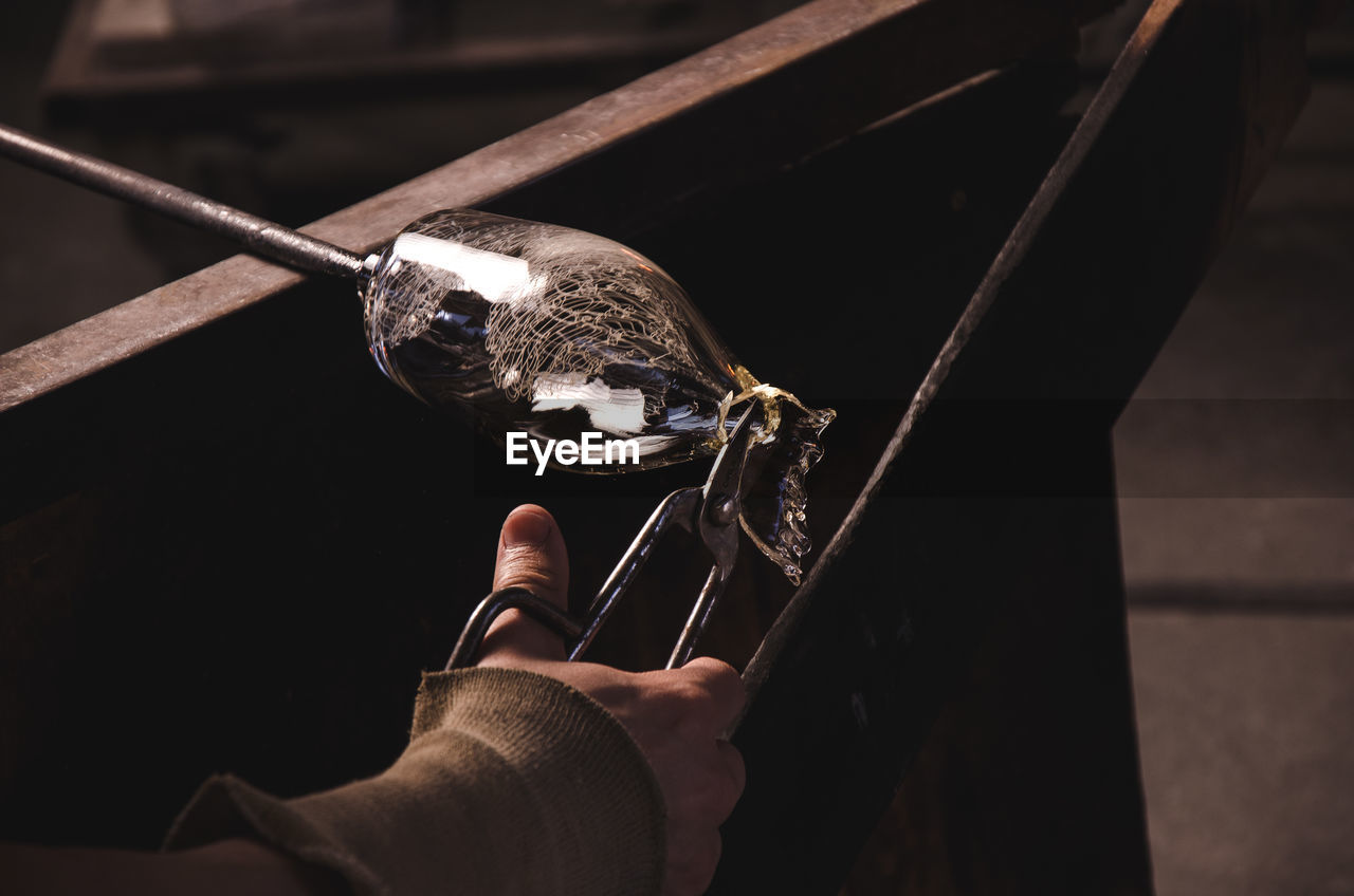 Close-Up Of Man Making Glassware