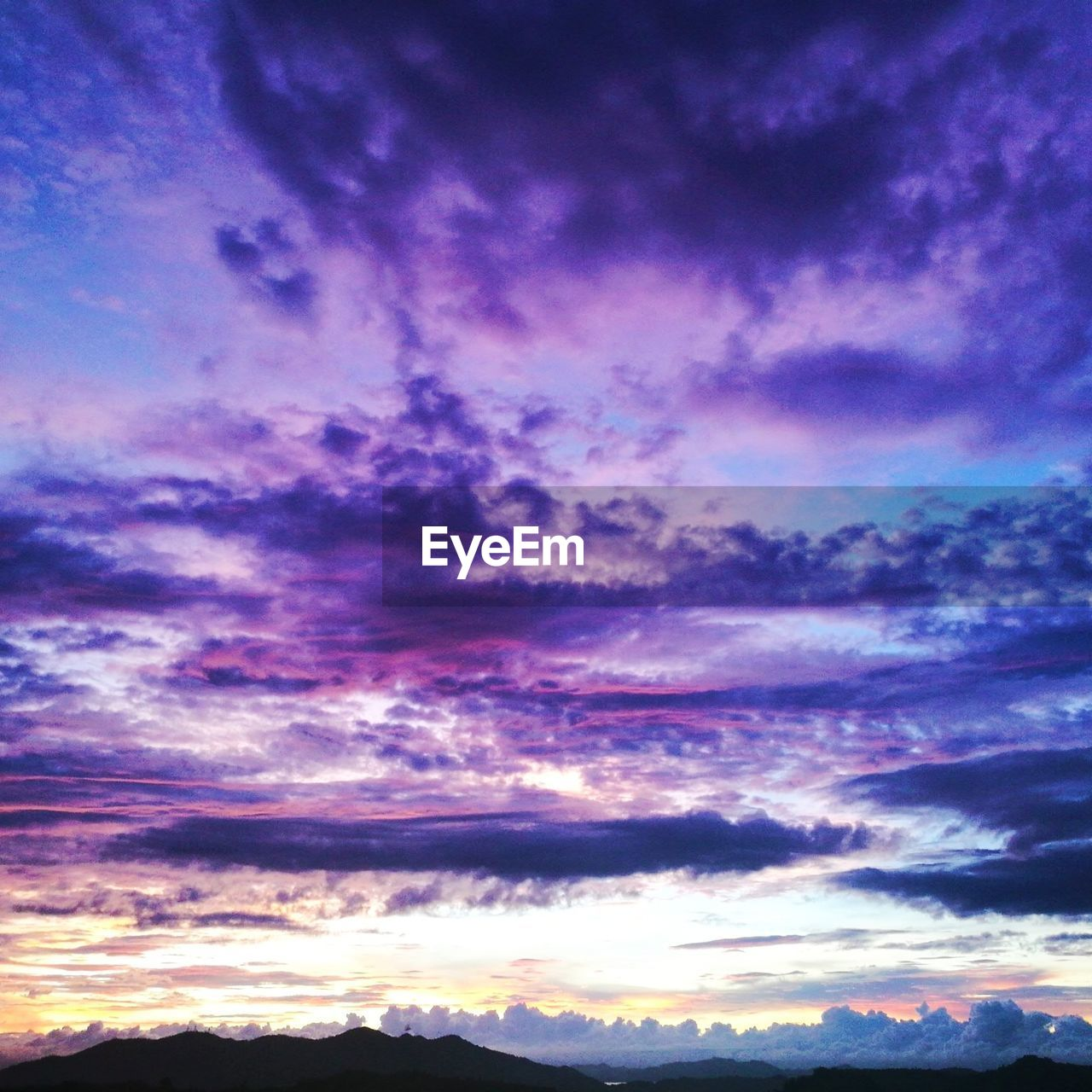 cloud - sky, sky, sunset, beauty in nature, scenics, nature, tranquil scene, dramatic sky, cloudscape, tranquility, backgrounds, no people, low angle view, idyllic, outdoors, purple, silhouette, sky only, multi colored, awe, day