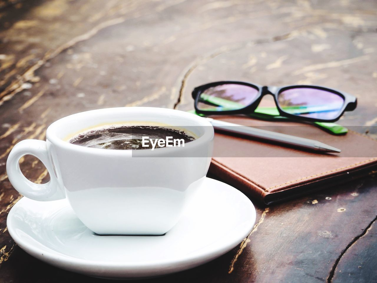 glasses, eyeglasses, food and drink, table, drink, cup, mug, refreshment, still life, coffee cup, coffee, coffee - drink, close-up, no people, focus on foreground, food, indoors, crockery, sunglasses, fashion, personal accessory, eyewear